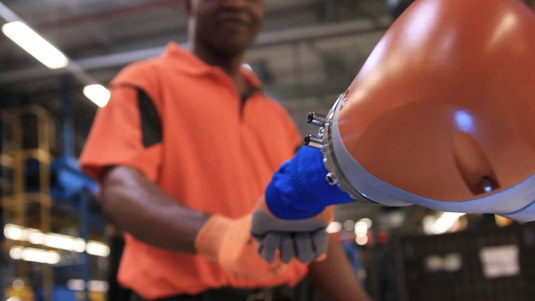 Car-Workers-and-Mini-Robots-Work-Hand-in-Hand–5